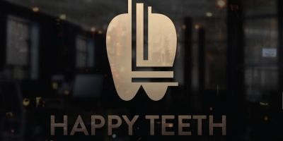 L letter Tooth logo
